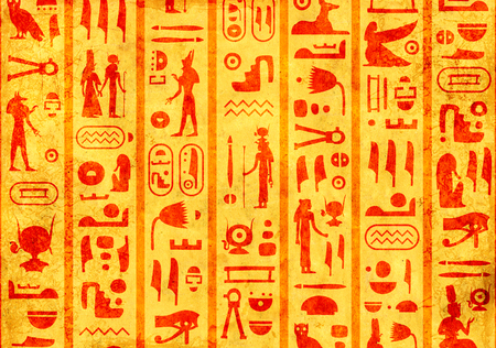 Grunge background with old paper texture of yellow color and ancient egyptian hieroglyphs and symbols Stock Photo