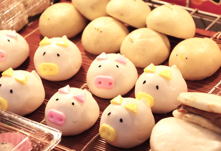 Street food - traditional Chinese animal-shaped mantou buns - pigs and chicken, street market in Chinatown, Kobe, Japan Stock Photo