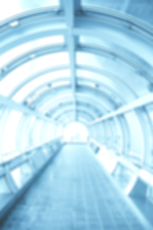 Blurred background with futuristic tunnel. Photo toned in blue color