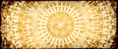 Grunge background with paper texture and detail of an ancient ornamental tile ornament in the Moroccan style