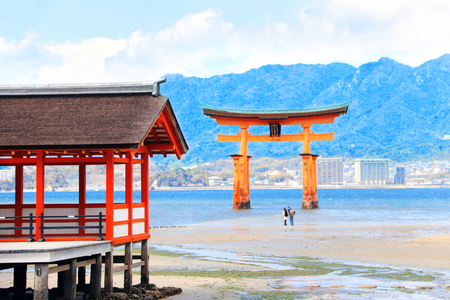 Pavilion of Itsukushima Shrine and Floating Torii gate (O-Torii), sacred Miyajima island, Hiroshima, Japan.    site. Focus on pavilion