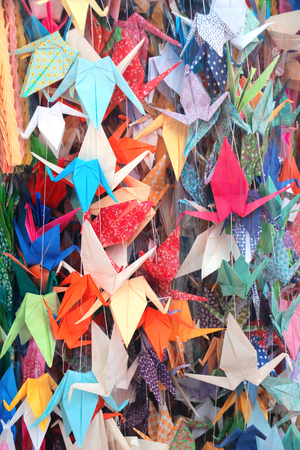 Many colored paper cranes to commemorate of child victims of the atomic bombing, Hiroshima, Japan Stock Photo