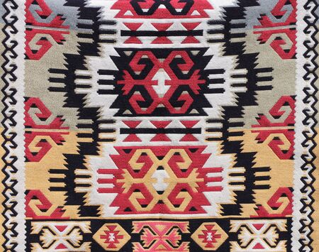 Texture of traditional turkish wool carpet with geometric pattern, Turkey