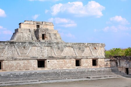 Ancient Mayan pyramid of the Magician in Uxmal and royal complex, Yucatan, Mexico.