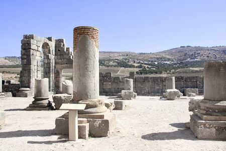 Ruins and columns of the Basilica in Volubilis, Roman city near to Meknes, the ancient capital of Mauritania. Morocco, North Africa.