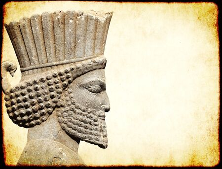 Grunge background with paper texture and bas-relief of head of persian warrior. Copy space for text. Mock up template Stock Photo