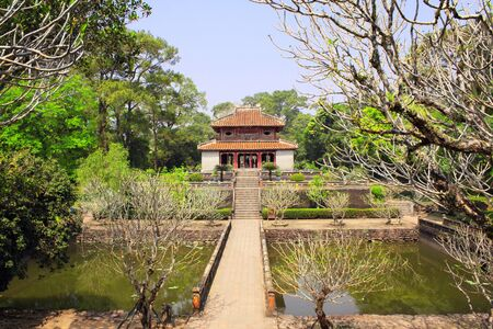 Ancient pavilion and ponds in Imperial Minh Mang Tomb of the Nguygen dynasty in Hue, Vietnam. UNESCO world heritage site 스톡 콘텐츠