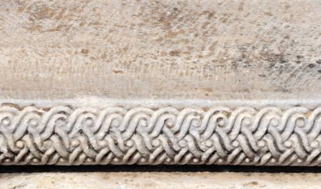 Detail of an ancient ornamental carved stone wall with floral border, Pergamon, Turkey. Mock up template. Copy space for text