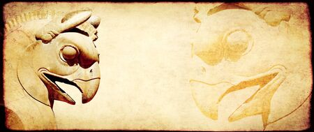 Grunge background with paper texture and bas-relief of head of griffin. Copy space for text. Mock up template Imagens