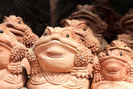 Traditional cambodian handmade souvenirs - wooden toads. Wooden frog figurine - asian mascot for good luck and wealth
