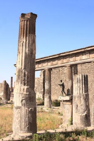 Ancient columns in ruins of Apollo Temple, Pompeii, Naples, Italy.