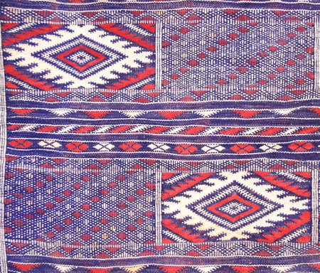 Texture of berber traditional handmade wool carpet with geometric pattern, Morocco, Africa