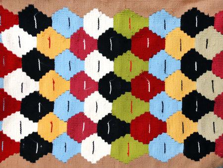 Texture of iranian traditional handmade wool carpet with geometric pattern, Iran Stockfoto