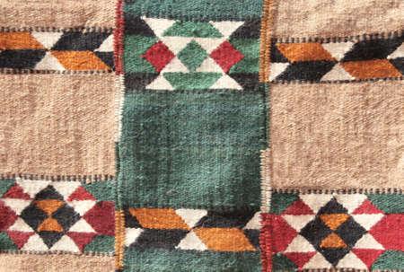 Texture of iranian traditional handmade wool carpet with geometric pattern, Iran