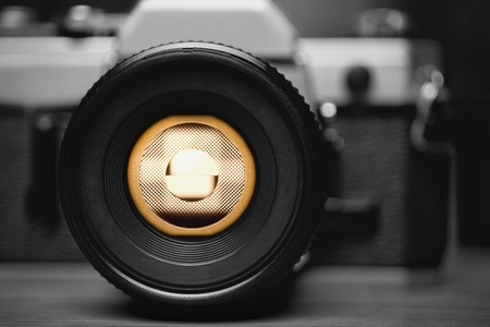 camera shutter: Old Retro Film Camera Closeup with Backlight Through the Viewfinder