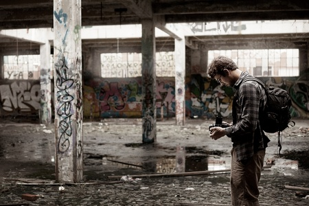 abandoned factory: Photographer Taking Pictures of an Old Abandonned Factory Editorial