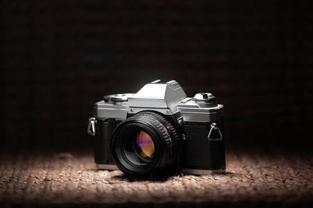 Vintage 35mm film camera under a spot light