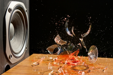 subwoofer: Loud Music Can Cause Damage - Studio Shot of Glass of wine exploding in front of a loud Subwoofer