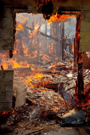 wood fire: Door frame of a House completly destroys by the fire Stock Photo