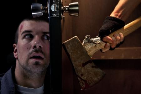 Dangerous killer wirh axe on the other side of the door