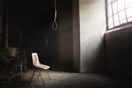 spooky house: Hangman Noose with thirteen loops setup in an abandoned building  Beautiful rays of light coming from the window