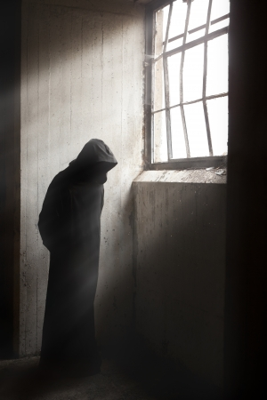 Scary Reaper waiting in a dark abandoned building Archivio Fotografico