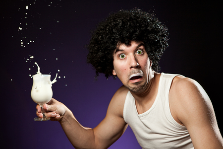 Man with mustache that got caught whle he was drinking a glass of milk at night