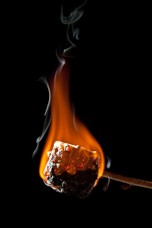 Overcooked Marshmallow on a Wooden Stick and still Burning