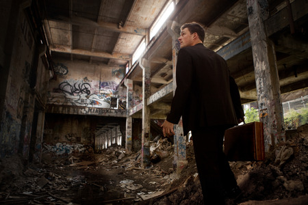 Confused Business man inside a completely Destroyed Building (concept)