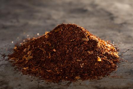 rooibos: Dried Rooibos Tea on a metal texture