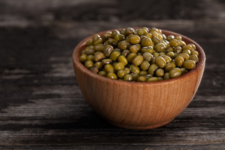 Close-up of Green Peas Sprouting Seeds in a Wooden bowl photo