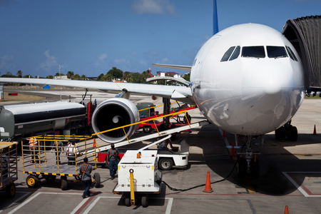 Airplane Unloading the Luggages at San Andres Airport in Colombia
