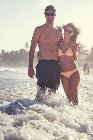 Beautiful Couple on the beach Having Fun in San Andres Island, Colombia photo