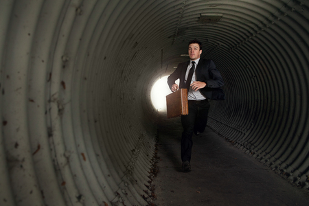 escape: Busy Businessman Running in a tunnel. With Room for your Text.