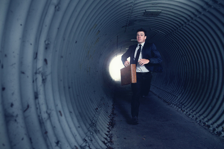 fleeing: Busy Businessman Running in a tunnel. With Room for your Text.