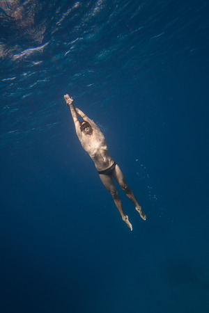freediver: Freediver with no fin Underwater in San Andres, Colombia