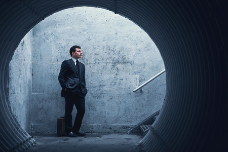 Patience is a virtue… Businessman waiting for something or someone in a tunnel Standard-Bild