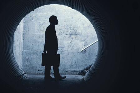 Side view of a Businessman looking in front of him in a tunnel. With room for your text Standard-Bild