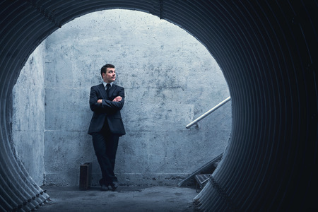 patience: Patience is a virtue… Businessman waiting for something or someone in a tunnel