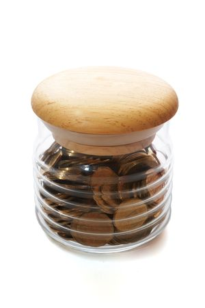 spendthrift: coins in glass jar