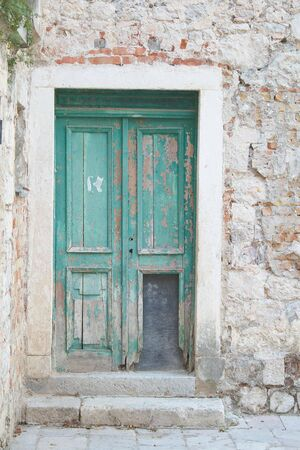 front entry: Antique old destroyed green door