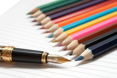 Office tools. Golden Pen and colored wooden pencils photo