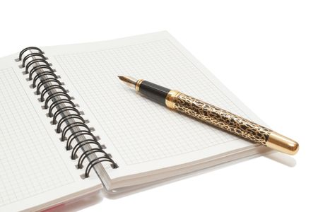 Golden Pen and notebook Stock Photo - 6810226