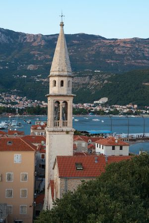 Clock tower in the evening in old city of Budva, Montenegro photo