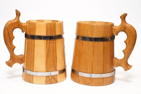 wooden beer mugs isolated on white background photo