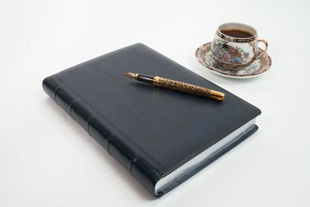 Golden Pen on notebook and cup of coffee Stock Photo - 6837315