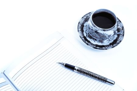 Morning planning for the day in a notebook with a cup coffee. Blue stile. Isolated on white. photo