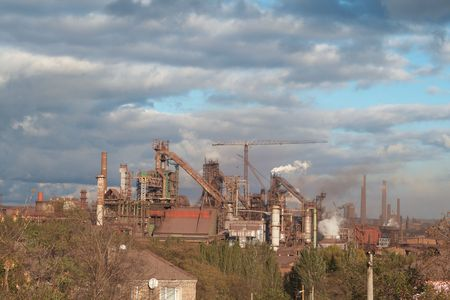 old Soviet metallurgical plant on the background of a beautiful sky photo