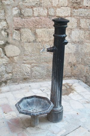 Old water pump in the old town. Kotor, Montenegro. photo