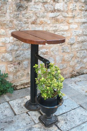 Ancient table is made on the basis of street Old water pump Stock Photo - 6839149